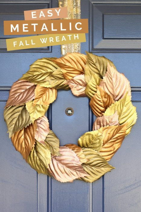 Metallic painted leaf wreath on a blue door