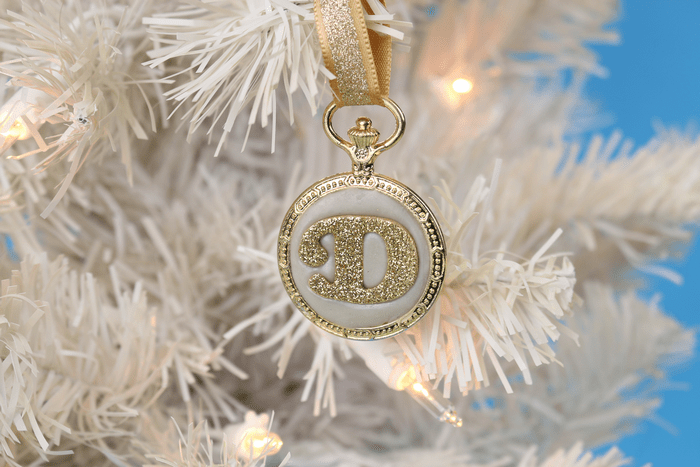 DIY Gold monogram ornament hanging on a white tree