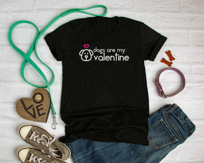 black t-shirt with SVG design that reads Dogs Are My Valentine in vinyl, next to dog leash and collar
