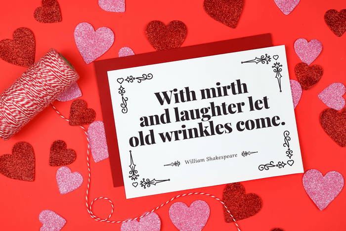 Shakespeare Valentine card with red envelope next to baker\'s twin and glitter hearts