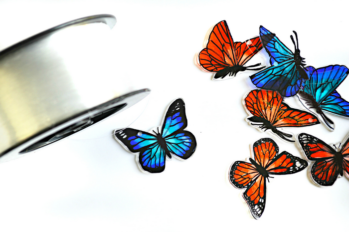 blue and orange shrink plastic butterflies and monofilament