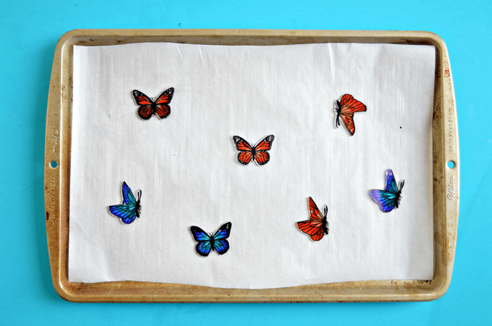 small blue and orange shrink plastic butterflies