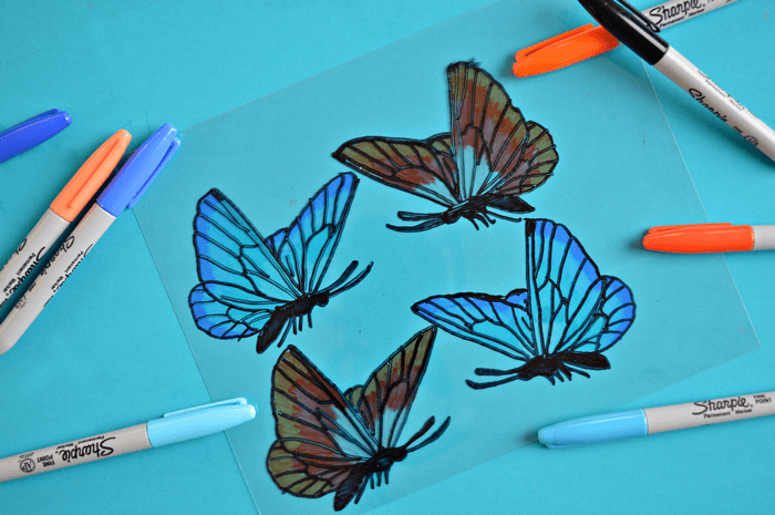 blue and orange sharpies and shrink plastic