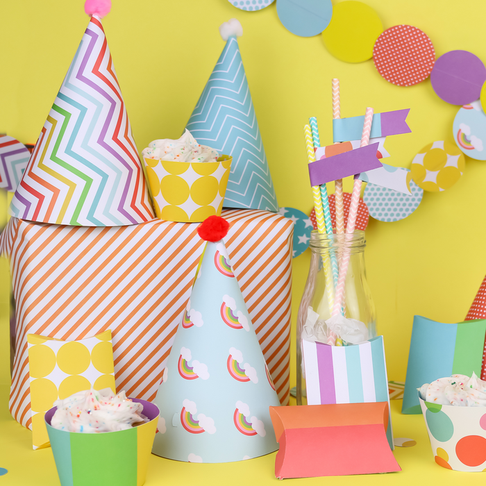 Colorful paper party supplies made with a Cricut machine