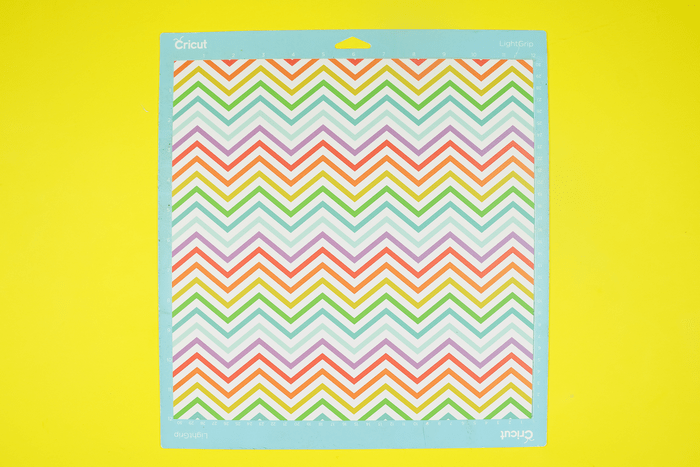 colorful chevron paper on a Cricut mat