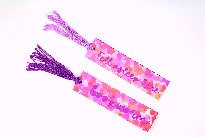Closeup of paper bookmarks with a tassel
