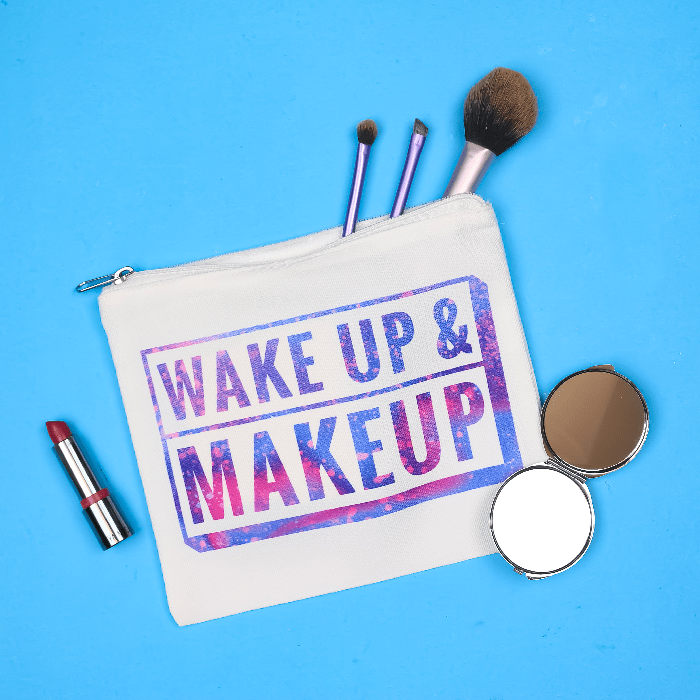 Wake up and Makeup Infusible Ink bag with makeup on a blue background