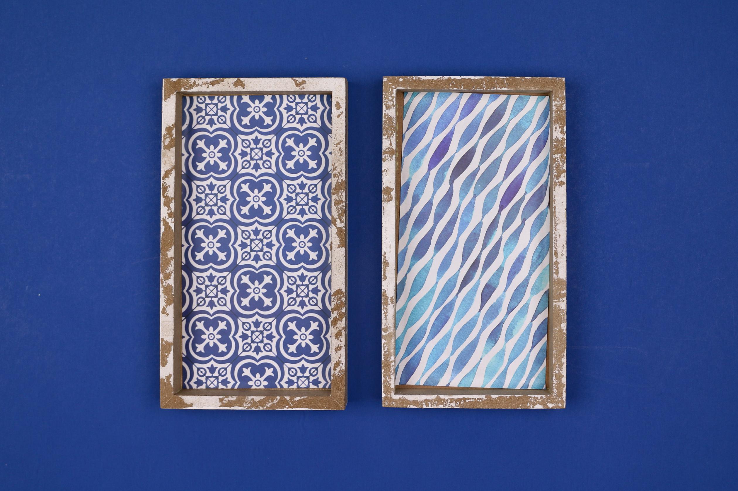 Blue patterned artwork on a blue background