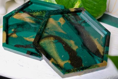 two marbled resin coasters