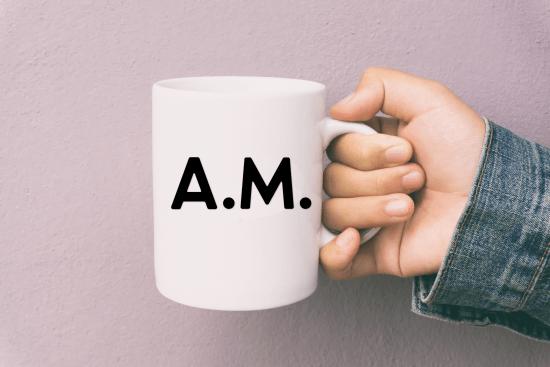 hand holding coffee mug with AM SVG design