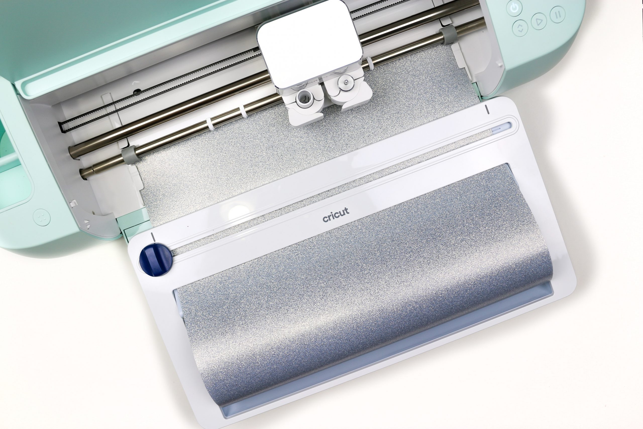 Cricut Explore 3 and roll holder with silver vinyl