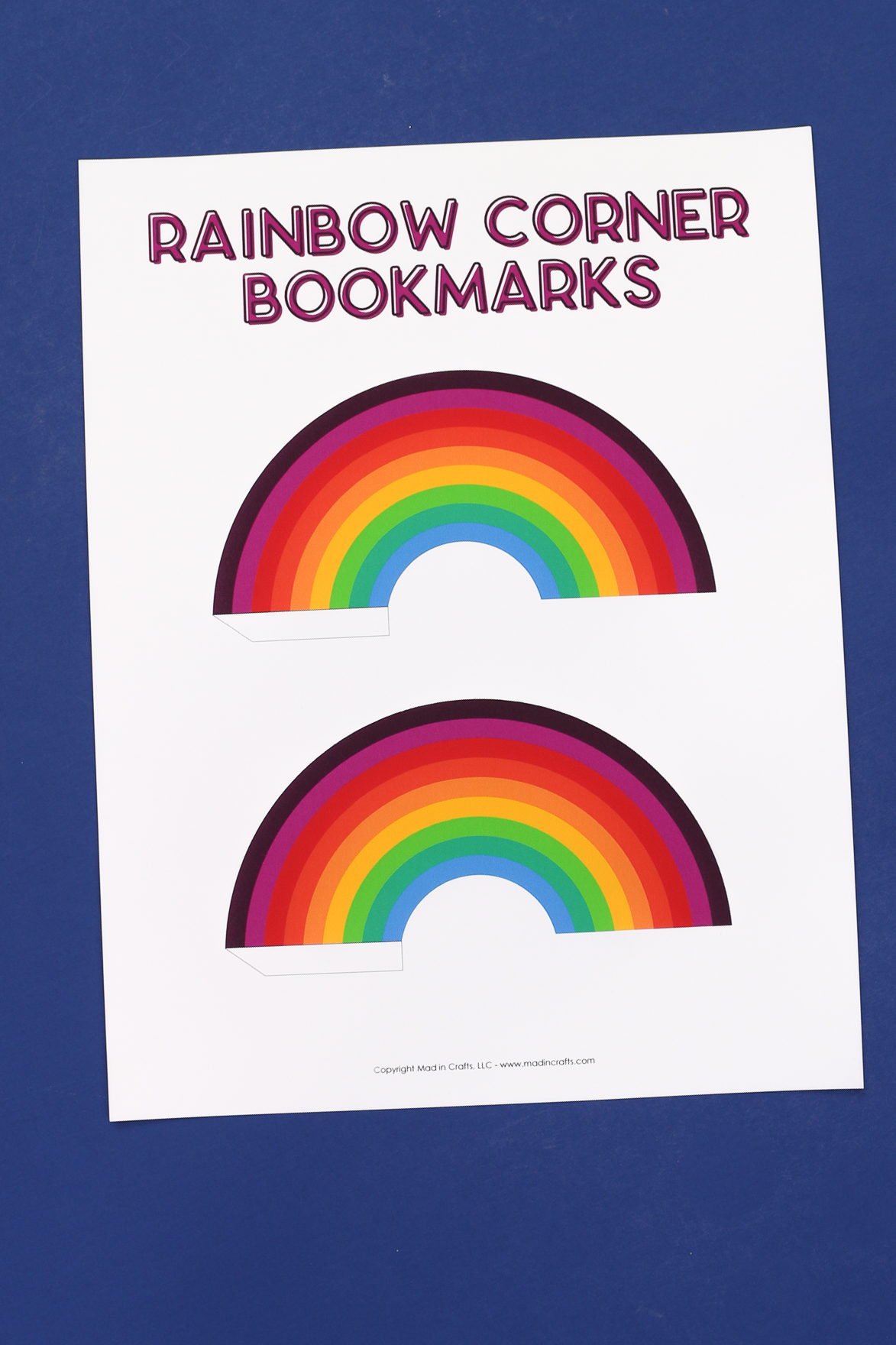 a printed paper with rainbow corner bookmarks