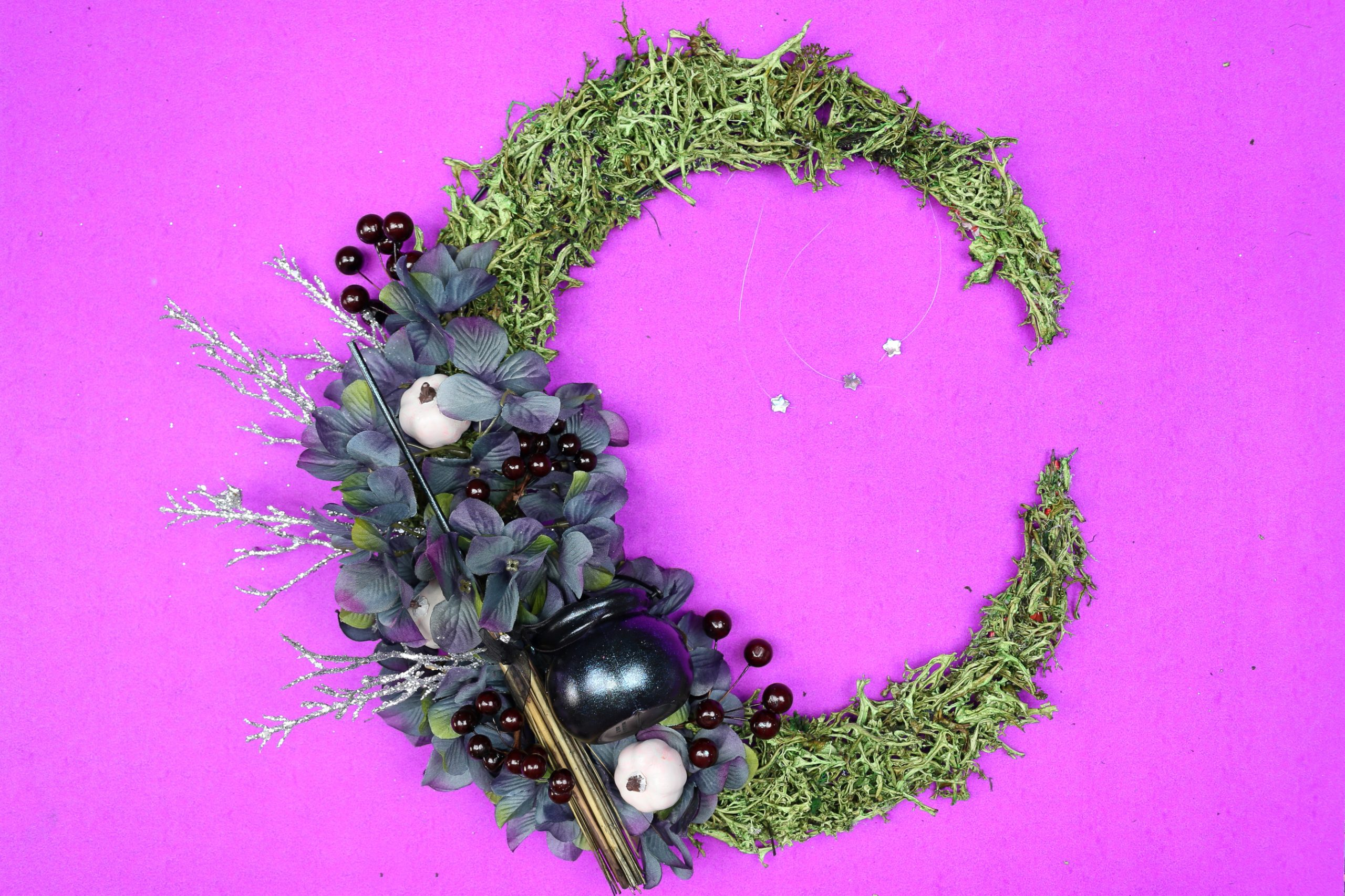 floral crescent moon wreath on a purple background