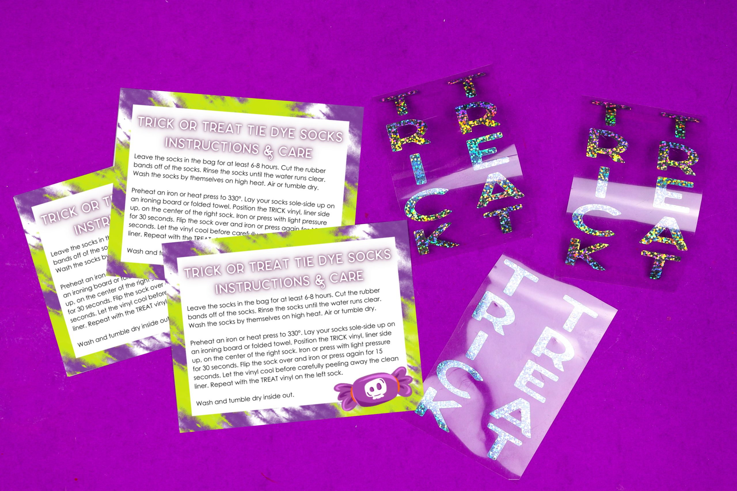tie dye instruction cards and weeded sparkle iron on vinyl on a purple background