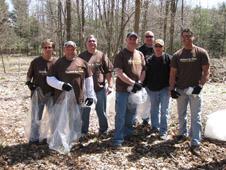 UPS volunteers pick garlic mustard