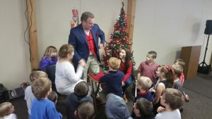 Jim Lutz of Jim Lutz Magic is pictured entertaining children at the seventh annual holiday party for town of Verona residents.