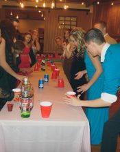 good ol flip cup. In formal wear