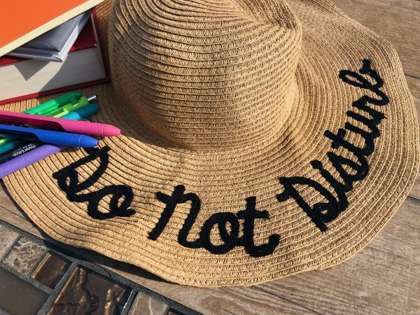 Do not Disturb sun hat, too busy.