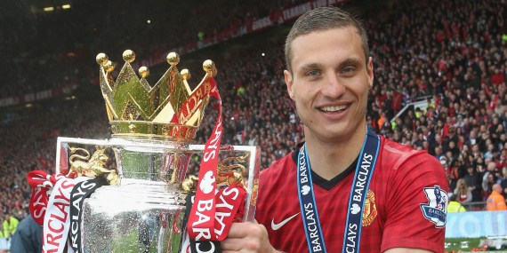 MANCHESTER, ENGLAND - MAY 12: Nemanja Vidic of Manchester United celebrates with the Premier League trophy after the Barclays Premier League match between Manchester United and Swansea at Old Trafford on May 12, 2013 in Manchester, England. (Photo by John Peters/Man Utd via Getty Images)