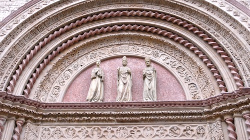 Romanesque decoration of the portal of Plazzo dei Priori in Perugia