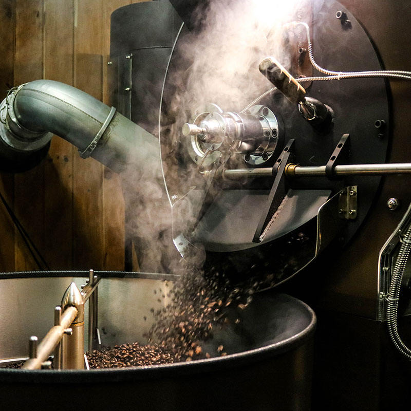 Steaming hot roasted coffee beans