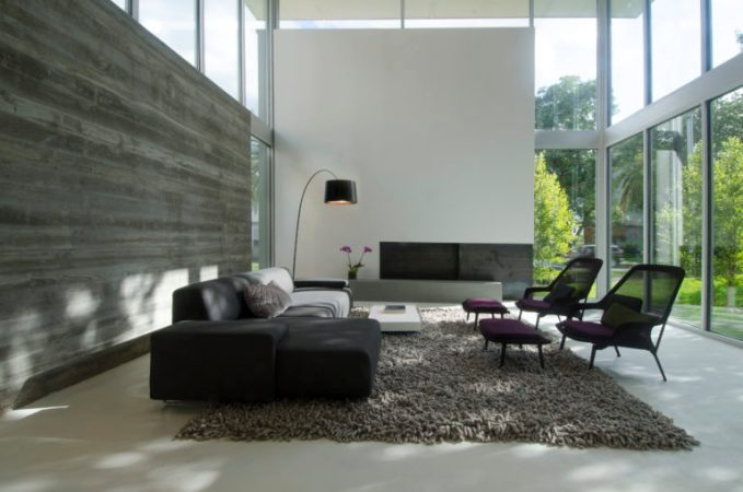 Great Room: Moroso Lowland Sofa by Patricia Urquiola upholstered in Kvadrat fabric,Vitra slow chairs and ottoman by Ronan & Erwan Bouroullec, Foscarini Twiggy floor lamp, Handmade Wool shag Nest rug by DWR, Custom Fireplace with sustainable Ecosmart Bioethanol linear fire element | Photo: Rame Hruska
