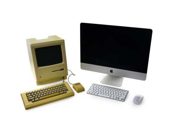 Macintosh 128k next to a Late 2013 iMac