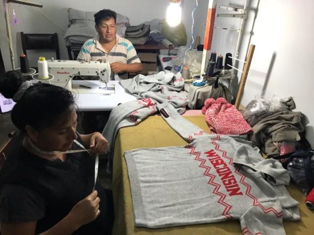 Artisans in Peru handcrafting the Wisconsin hoodie