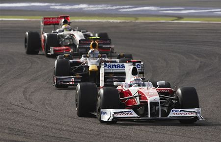 All aboard: Jarno Trulli leads the pack
