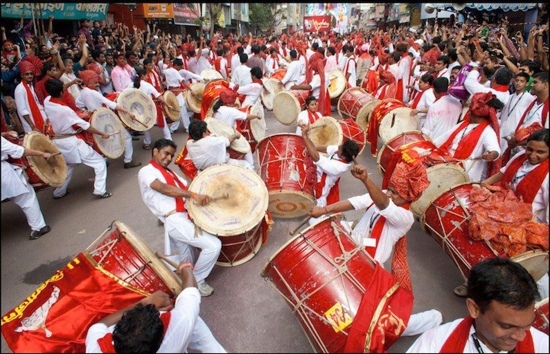 Image result for people playing nasik dhol