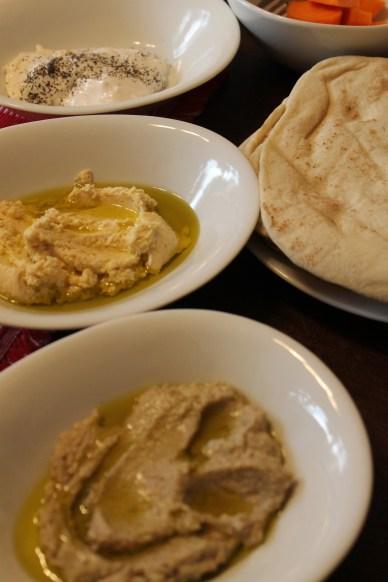 Hummus, babaganoush, labnah, and pita bread.