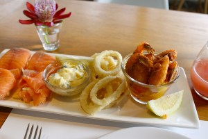 Smoked salmon, calamari with tartar sauce, and panko crusted shrimp with mango salsa.