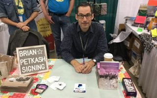 Author Brian Petkash signing books at AWP 2020