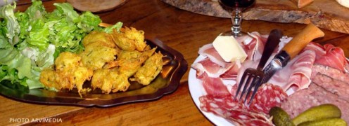 A photo of our deep-fried potato balls (left) and charcuterie plate (right), courtesy of alteralpatourisme.com.