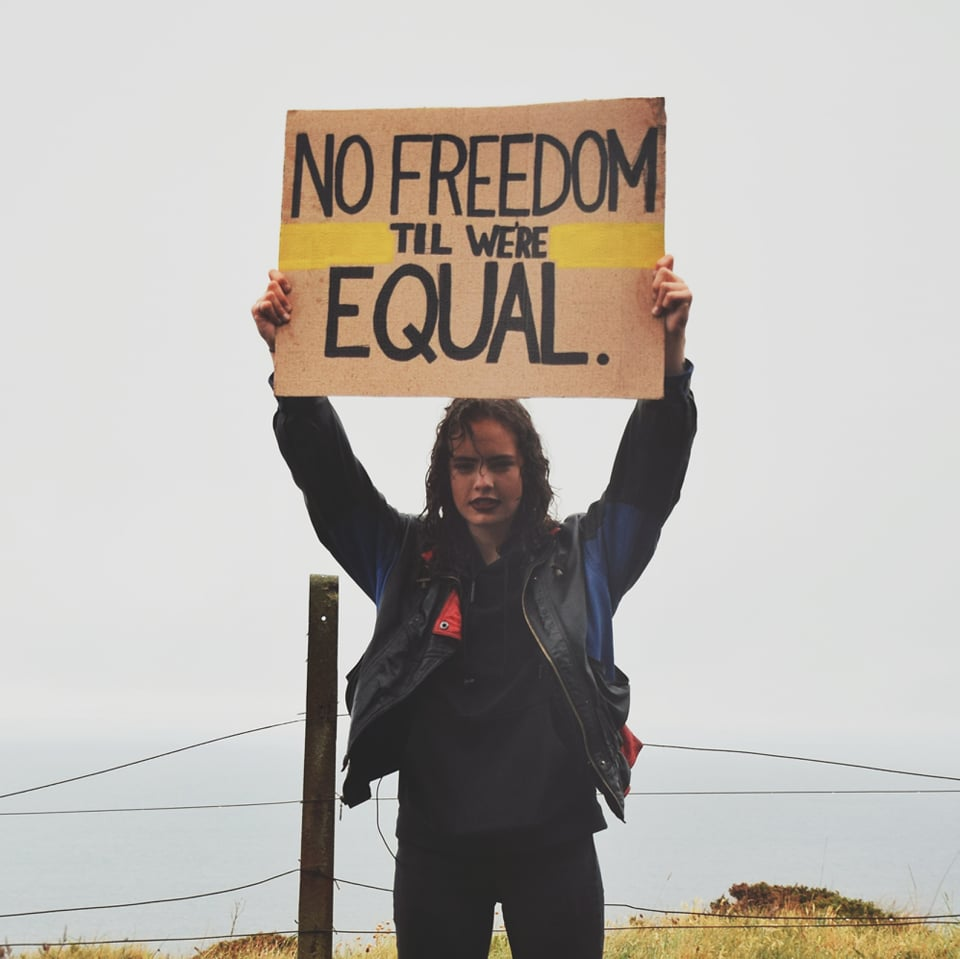 Mae Challis holding a Freedom sign for Equal video