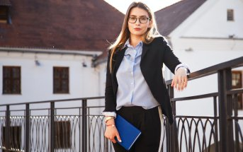 A young lady in a suit before the first in the life job interview.