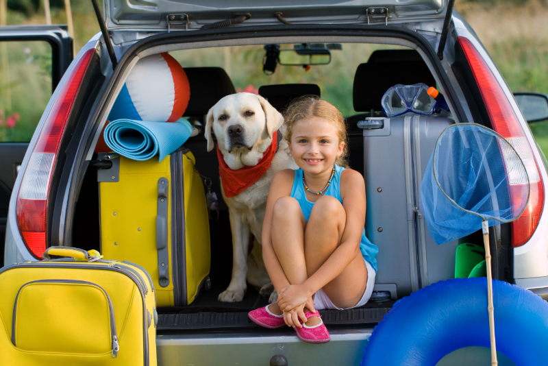 girl_and_dog_on_the_trunk