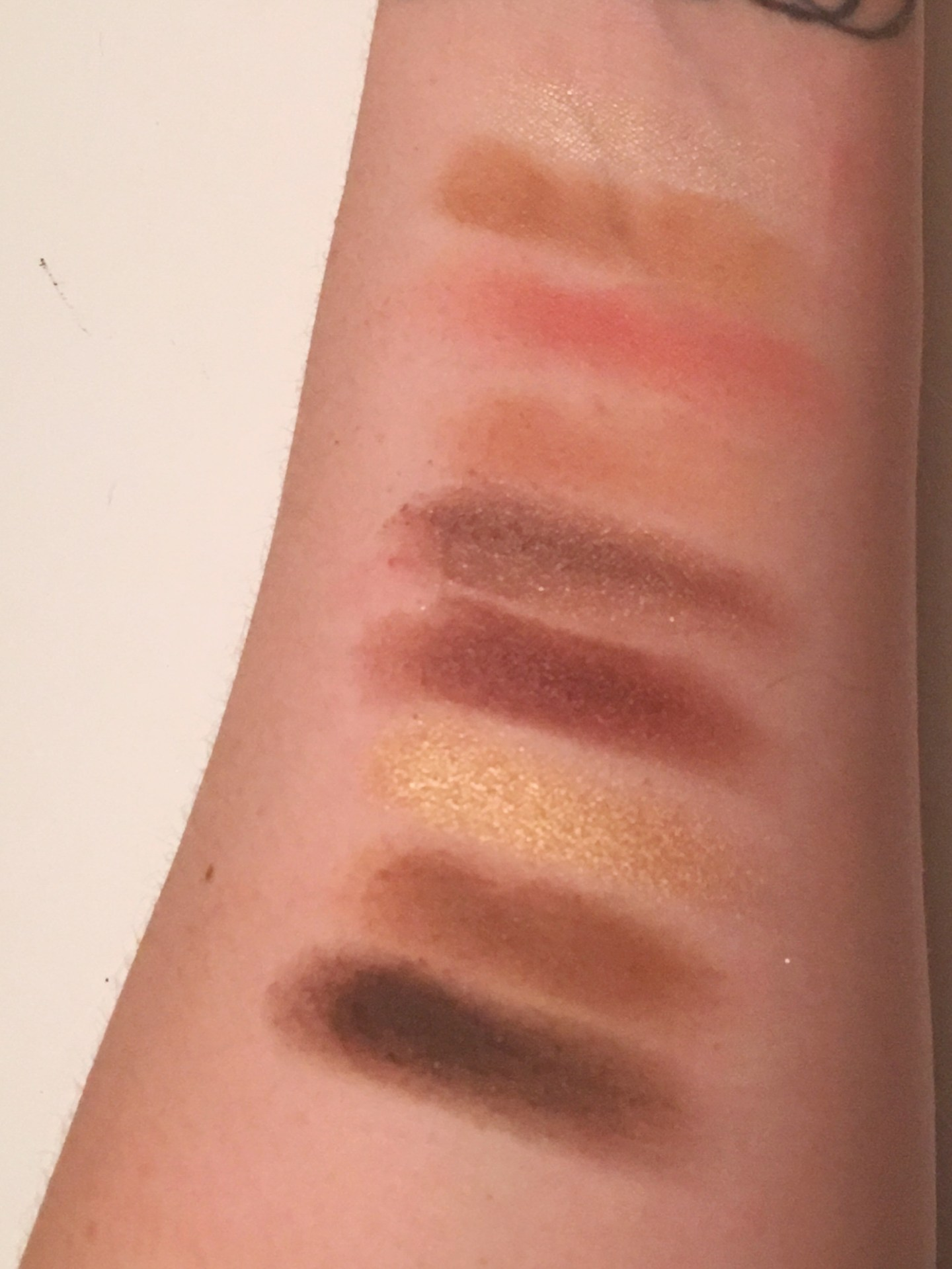 From top to bottom: Highlighter in Champagne, Bronzer in Park Avenue Princess™, Blush in Unleashed (nude rose), eyeshadows in: Bare to Explore (pink beige), Make a Mauve (plum mauve), Plum Away with Me (dark plum), Up to No Gold (gold), Tan-gled Up in You (tan), and Don't Turn A-Brown (dark brown).