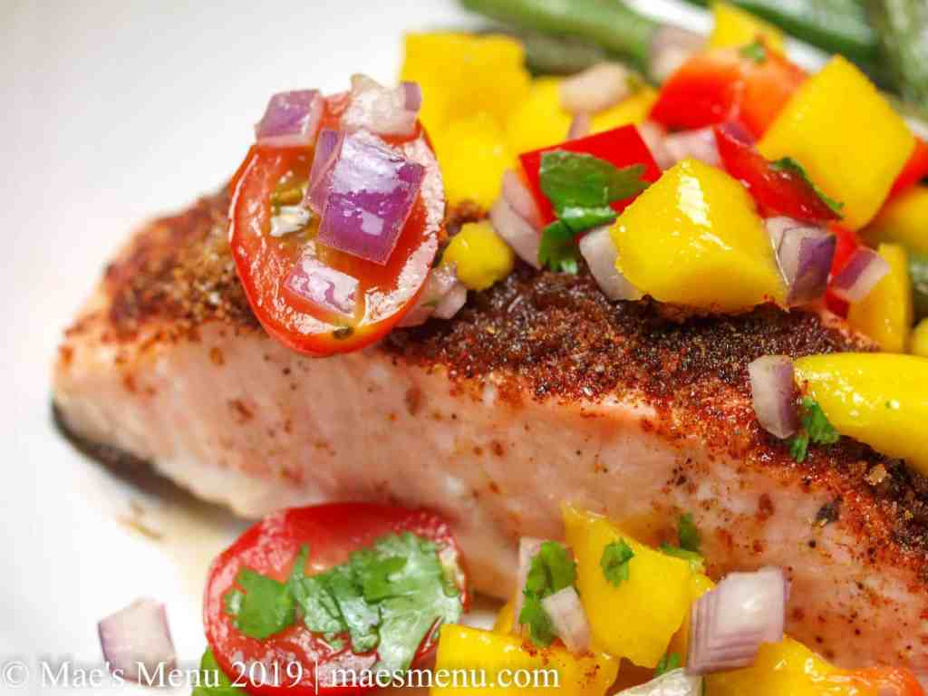 Up-close of spicy baked salmon with mango salsa.