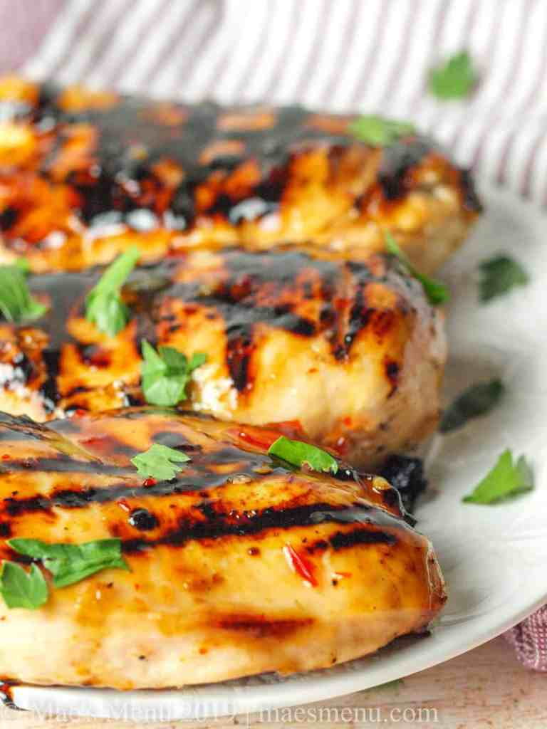 Up-close of grilled sweet chili chicken breasts.