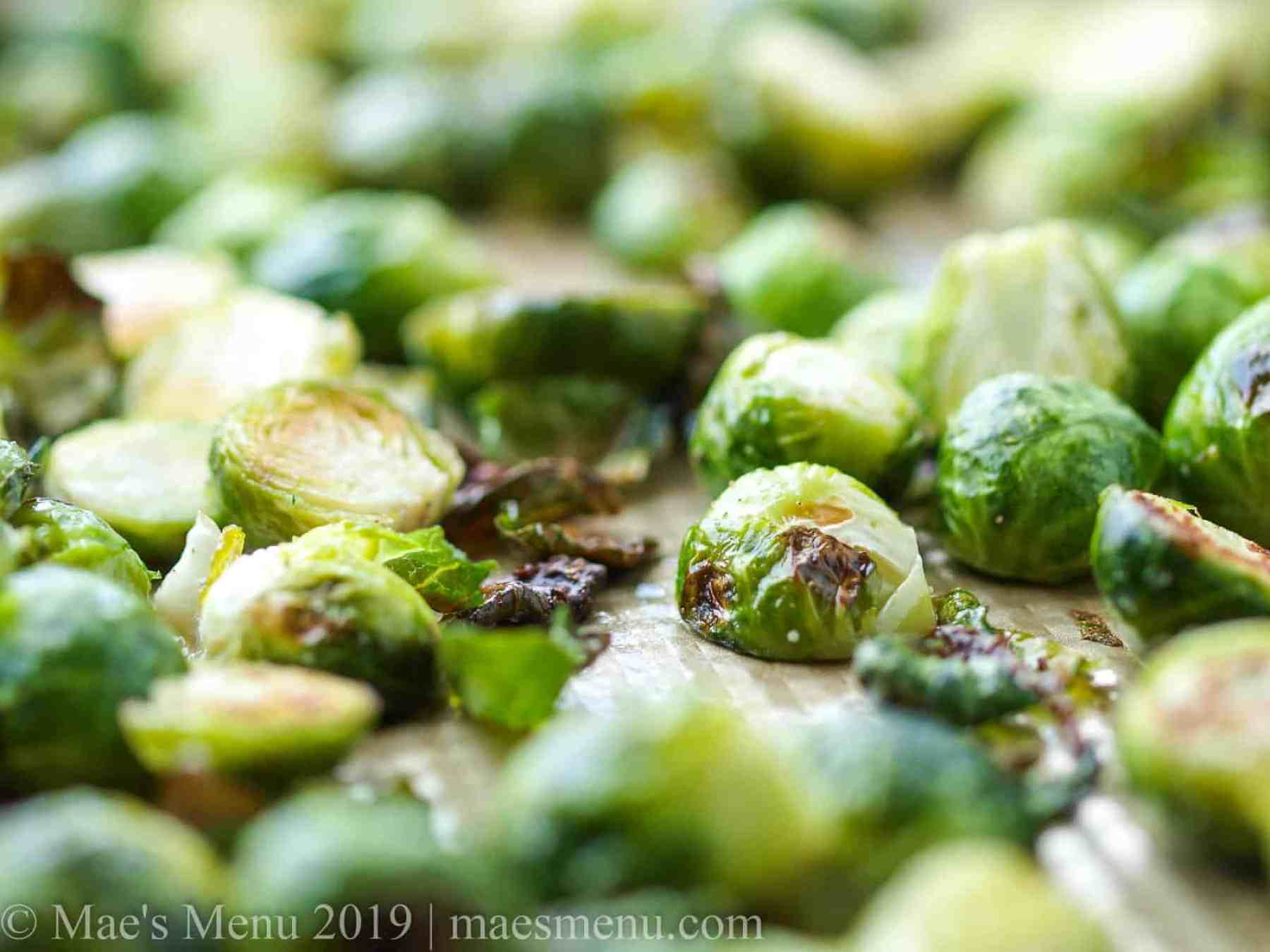 A large sheet pan of freshly roasted brussels sprouts.