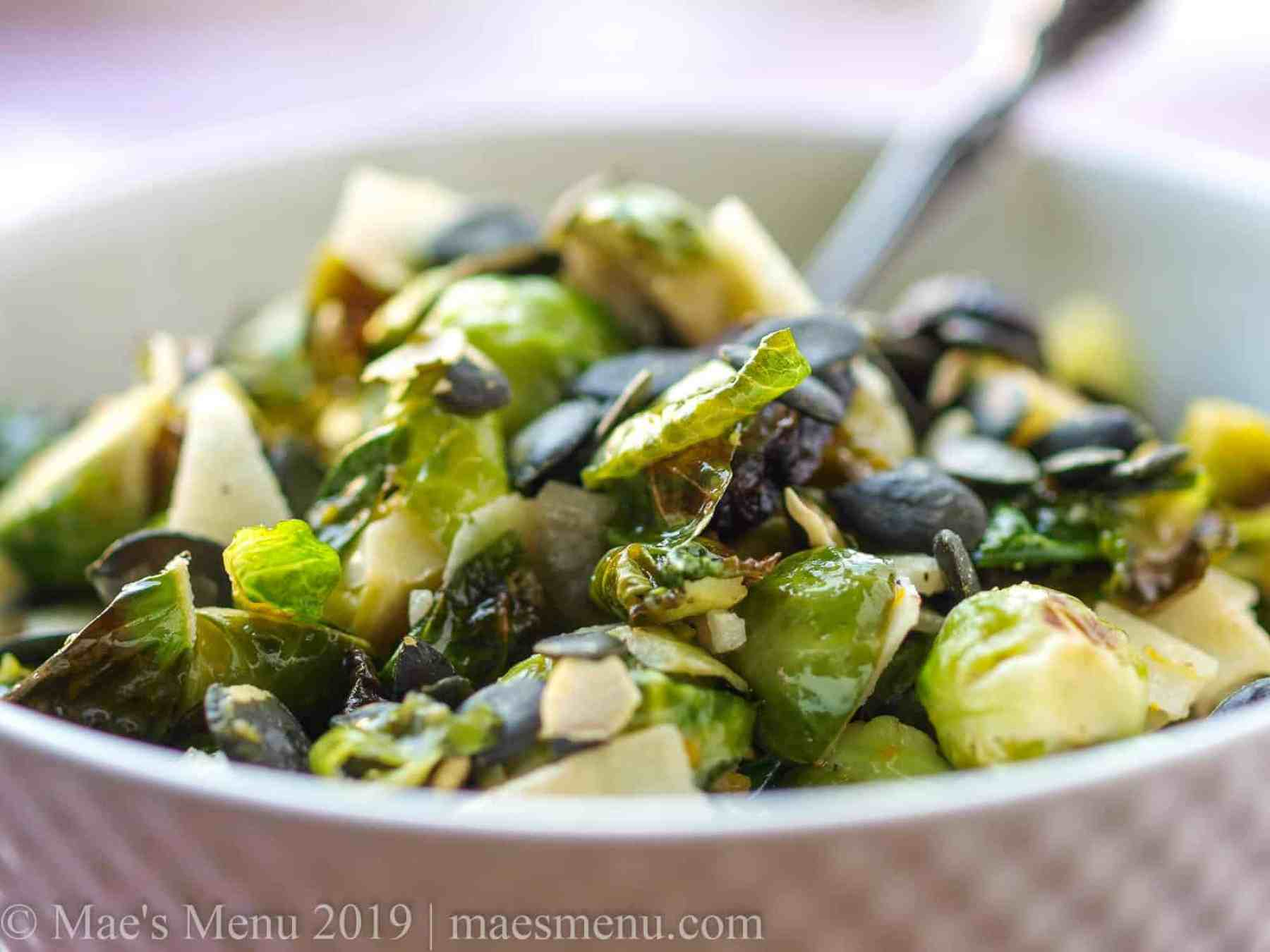 Up-close shot of healthy roasted brussels sprouts with manchego cheese, dried figs, and pumpkin seeds
