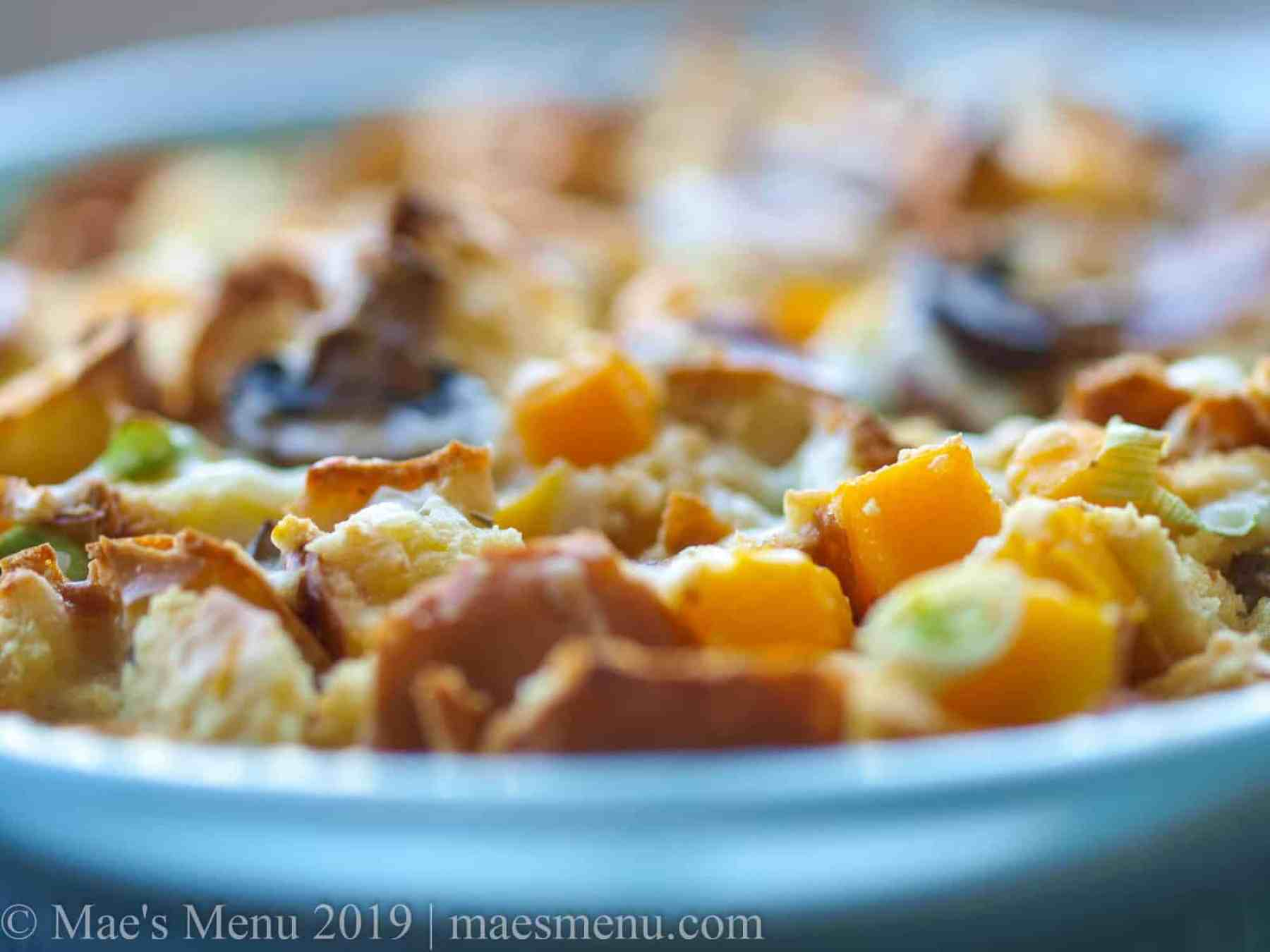 A side view of a crusty savory bread pudding.