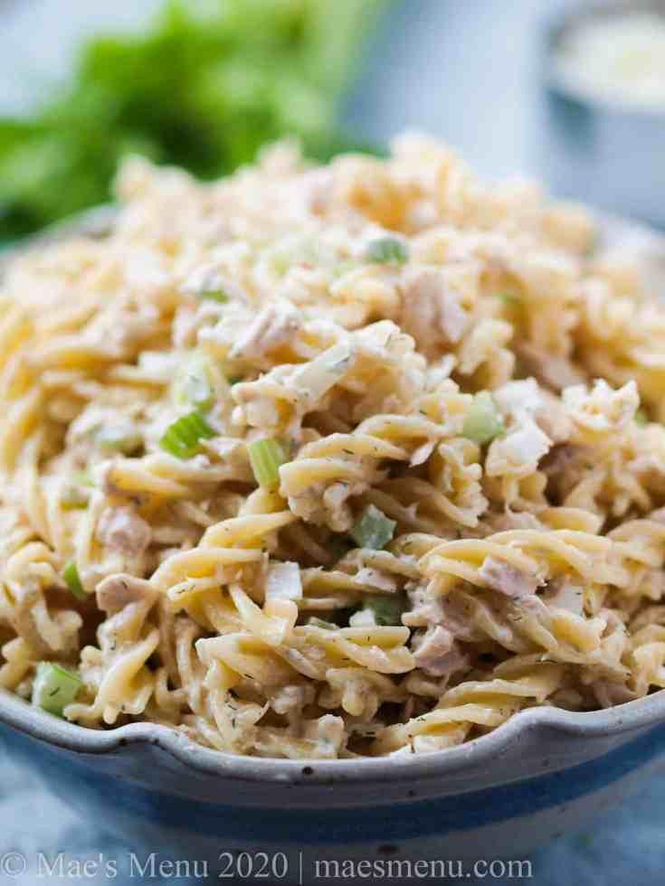 An up-close shot of a bowl of tuna macaroni salad.