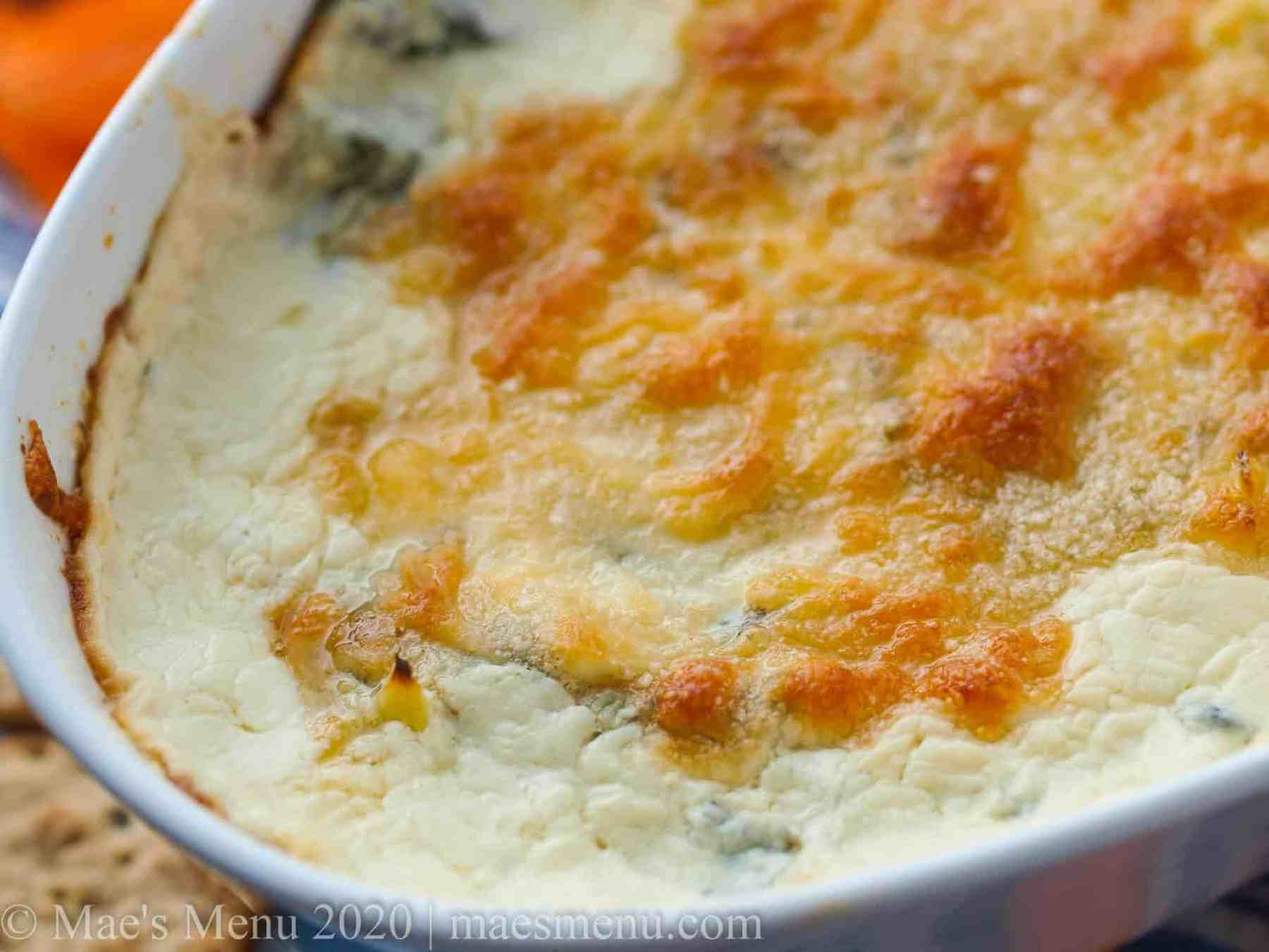 A large pan of baked healthy spinach dip.