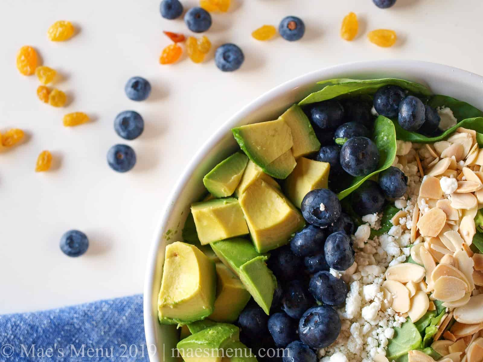 Blueberry spinach salad in a large white bowl.