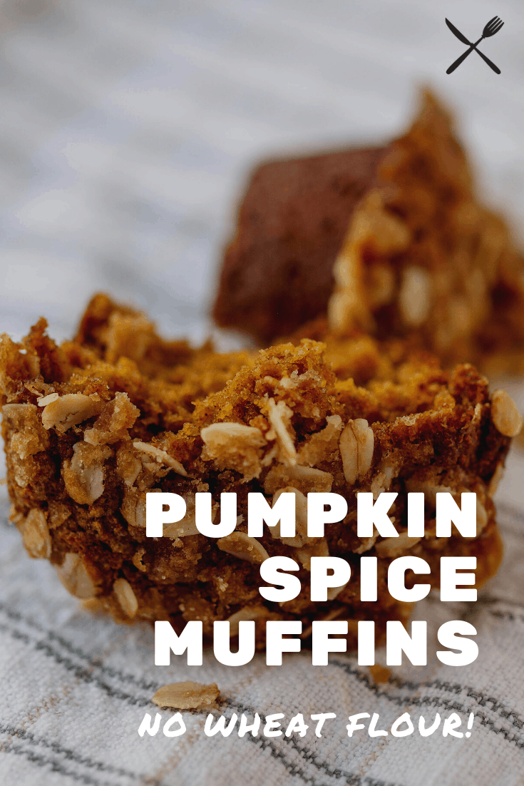 Pinterest pin for pumpkin spice muffins with no wheat flour! A muffin split in half on a towel.