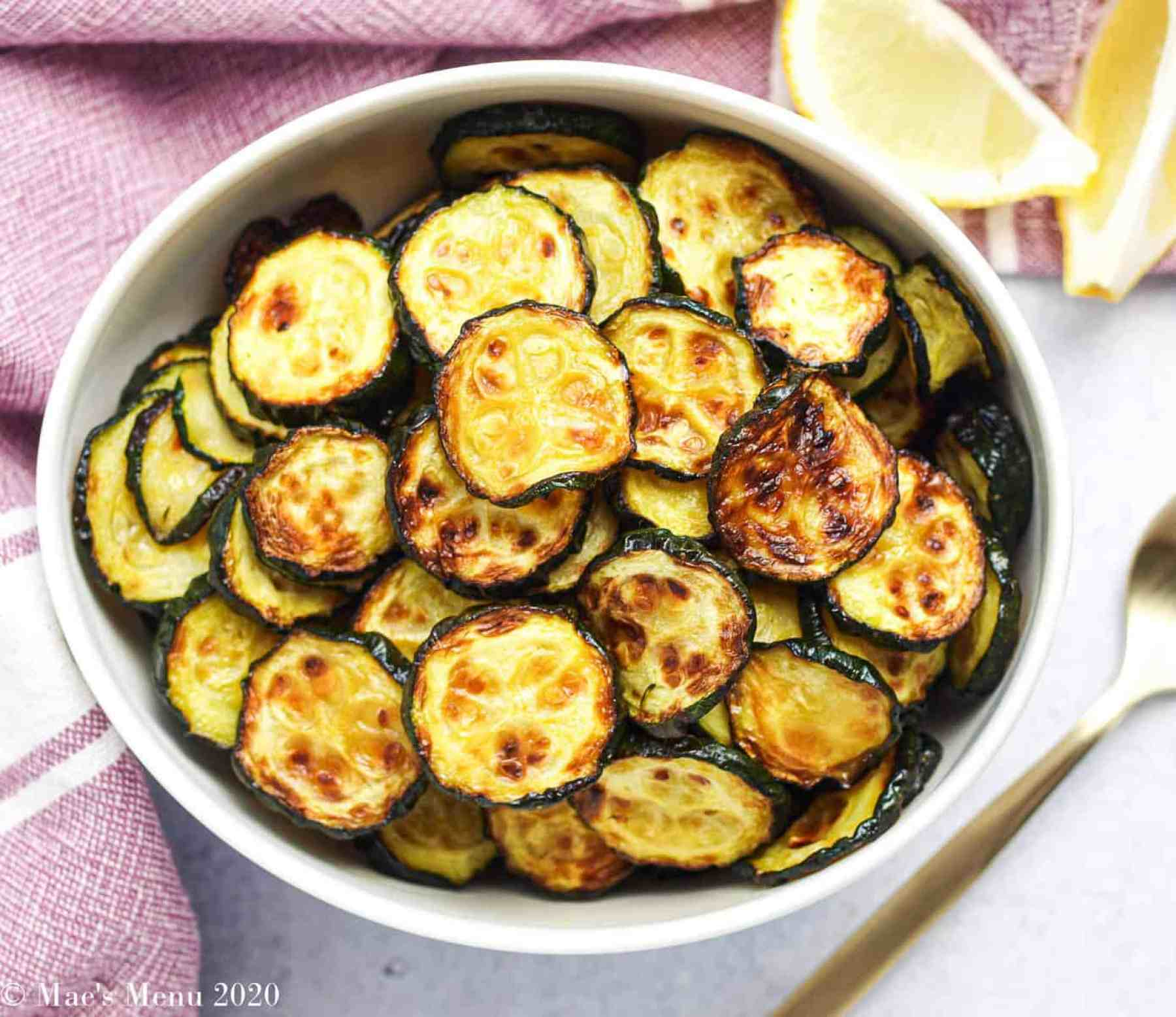 A small bowl of air fryer zucchini in a small white bowl