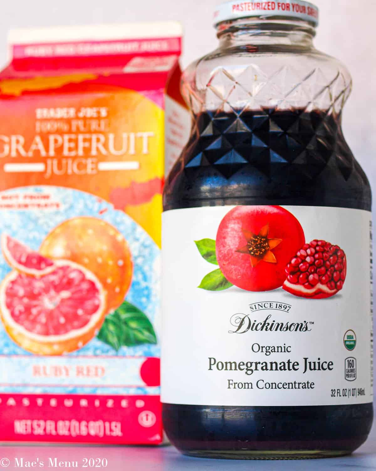 an up-close shot of a bottle of pomegranate juice and a carton of grapefruit juice