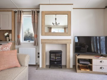 ABI Ambleside - 2021 - Log burner style electric fire in lounge | Maes Mynan Park